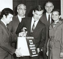 Director of Illinois Department of Transportation and Bruce Hannon with petition opposing dam project (1970s).