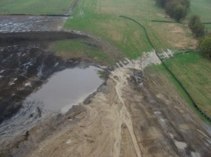 Silt fence controlling erosion from a factory farm construction site (credit: Helping Others Maintain Environmental Standards)